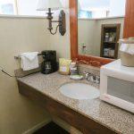 Merry Manor Inn Guest Room Vanity Microwave And Coffee Maker